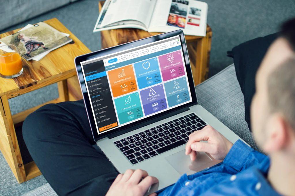 Man play banking simulator game on laptop