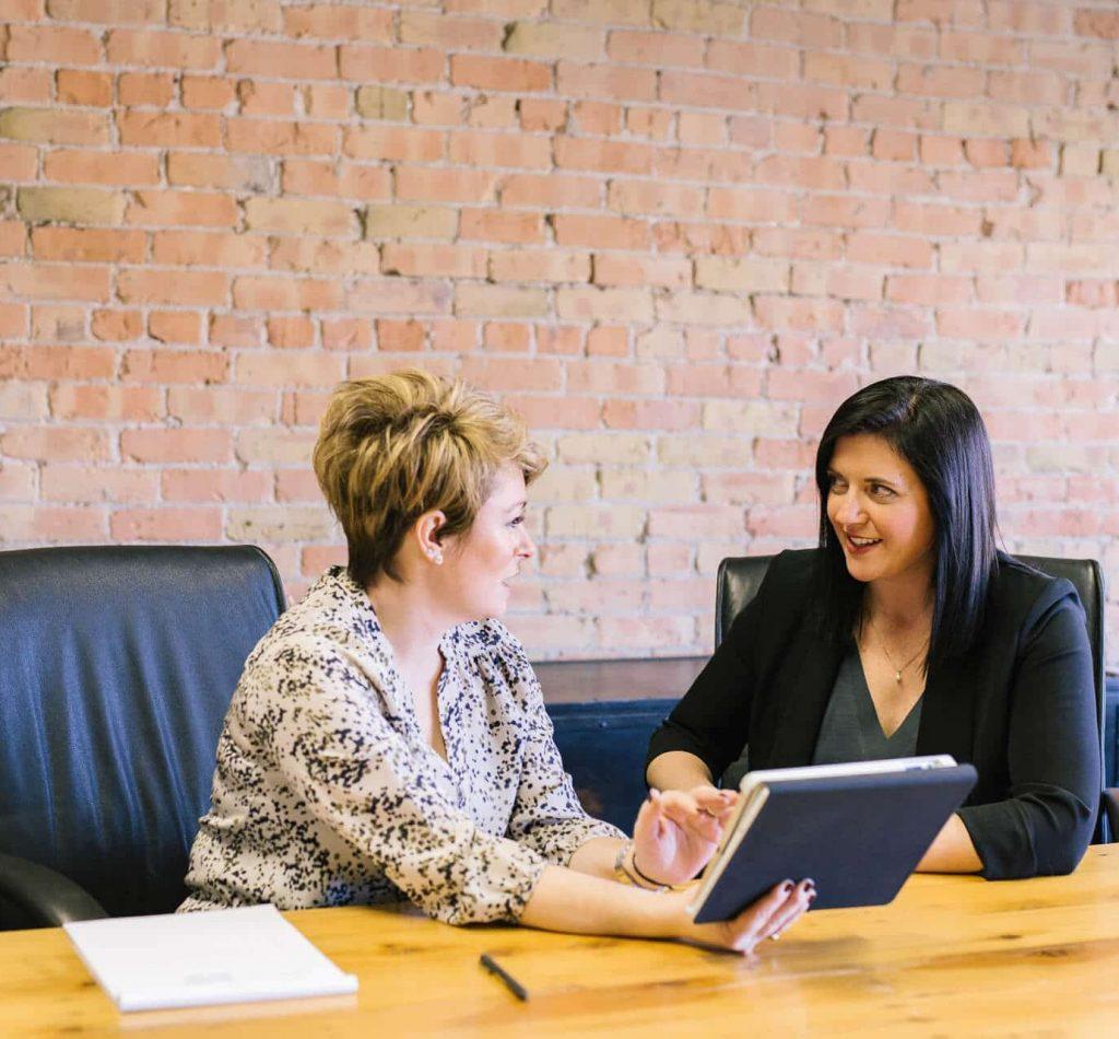 Ladies discuss tablet activity